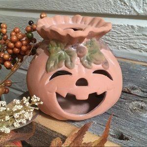 Pottery pumpkin tea light holder